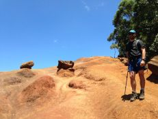 KK ascending the mud slope to the ridge top
