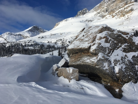 Snow drifts by the huge boulder atop Boulder Pass